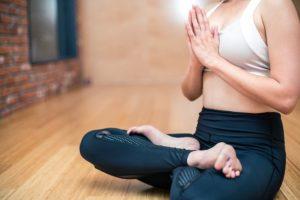 A woman doing the yoga lotus pose