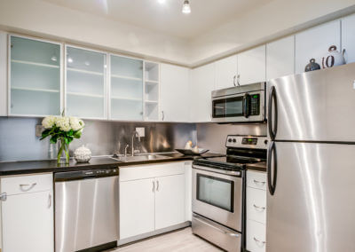 Large kitchen with a refrigerator and stainless steel appliances