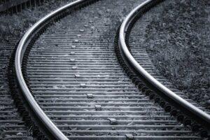 Black and white railroad train tracks